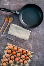 Still Life With Eggs And Pan On Wooden Table, Top View,Animal,Bread,Breakfast,Cholesterol,Circle,Close-up,Cooked,Cooking,Cooking Oil,Cooking Pan,Cutting Board,Drink,Egg,Egg Yolk,Farm,Food,Freshness,Fr
