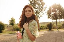 Pretty Young Lady In Floral Dress Enjoying A Walk Otdoors On A Sunny Day