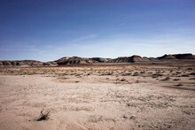 Panoramic View Of The Badlands Of The Petrified Forest Under A Blue Sky In Arizona, USA