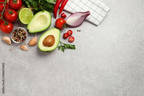 Obraz na plátně Fresh guacamole ingredients on light grey table, flat lay