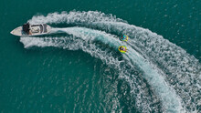 Aerial Photo Of Extreme Power Boat Donut Water-sports Cruising In High Speed In Tropical Emerald Bay