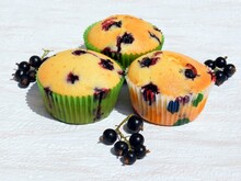 Summer Baking - Delicious Homemade Muffins With Black Currant In Colorful Paper Cups, Fresh Fruits Around