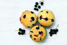 Summer Baking - Delicious Homemade Muffins With Black Currant In Colorful Paper Cups, Fresh Fruits Around, Top View