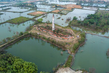 Aerial View Of A Disused Chimney In A Lagoon In Samastipur, Bihar, India.