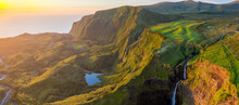 Aerial View Of A Small Waterfall And A Lake During A Beautiful Sunset At Ribeira Grande On Ilha Das Flores, Azores Islands, Portugal.