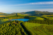 Aerial View Of Lagoa Da Lomba, A Small Lake Surrounded With Vegetation At Sunset On Ilha Das Flores, Azores Islands, Portugal.