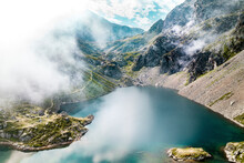 Aerial View Of The Lac Du Crozet With Fog, Lake Nestled Between Mountains Peak, Massif De Belledonne, Grenoble, Isere, Rhone-Alpes, France.