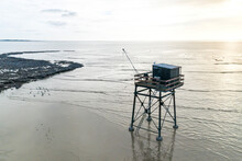 Aerial View Of A Fisheman's Cabin On Stilts With Fishing Nest During Low Tide In Pointe De La Fumee, Fouras, Moeze-Oleron Nature Reserve, Charente Maritime, France.