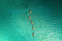 Aerial View Of Five Motorboats Near A Tropical Island, With Blue Ocean, In The Grand Cul De Sac Marin, Sainte Rose, Les Antilles, Guadeloupe, Eastern Caribbean Island.