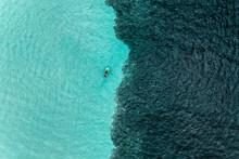 Aerial View Of People On A Jetski Cruising In The Ocean, Caribbean Sea, Grand Cul De Sac Marin, Sainte Rose, Les Antilles, Guadeloupe, Eastern Caribbean Island.