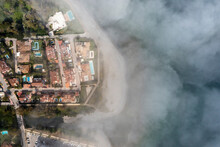 Aerial View Of The Coastline Covered With Fog Near Malaga, Andalusia, Spain.