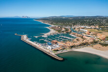 Aerial View Of Puerto Sotogrande, Cadiz City Port With Boat Anchored At Pier, Andalusia, Spain.