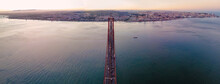 Panoramic Aerial View Of The Highway Road On April 25th Bridge Crossing Tagus River With Lisbon Downtown In Background, Lisbon, Portugal.