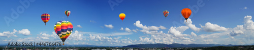 Fotografie, Obraz panorama of color hot air balloons in blue sky over the city background