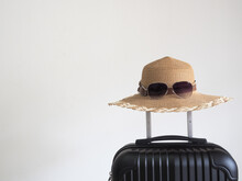 Closeup Retro Hat With Sunglasses Above Luggage On White Isolated Space Holiday And Travel Concept