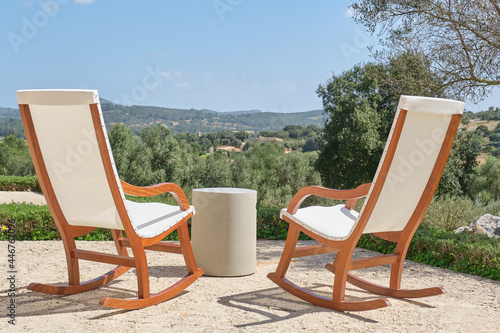 Fotografía Beautiful wood and fabric chairs set up to enjoy the beautiful view