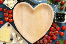 Heart Shaped Bowl, Tasty Red Wine And Snacks On Blue Wooden Table, Flat Lay