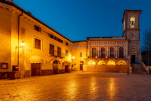 Piazza San Benedetto Square In The Historic Center Of Norcia, Italy, Illuminated By Evening Lights