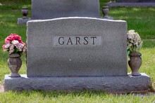 An Isolated Headstone At A Cemetery