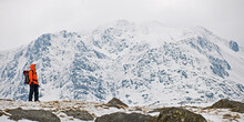Woman Hiking Around Mount Tryfan During Winter