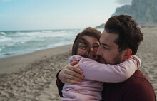 Father And Daughter On The Ocean Shore