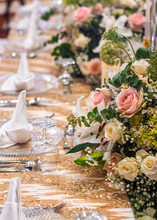 Gold Table Setting With Pink Flowers