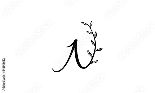 Valokuva initial letter N floral hand drawn botanical boho icon logo design vector illust