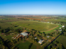 Empty Country Showground Oval And Racecourse Seen From The Air On Sunlit Day