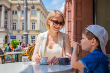 Mother With A Son In A Cafe On A Vacation In Wroclaw, Poland