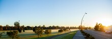 Panorama Of Misty Playing Fields And Road In Morning Light In Singleton