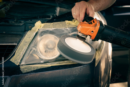 Canvas Print cleaning headlights with a buffer machine