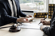 Attorneys Or Lawyers Are Advising Clients In Defamation Cases, They Are Collecting Evidence To Bring Charges Against The Parties For Damages. The Concept Of Defamation Case Counseling.
