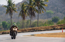 Man Practising Laps On Race Track With His Motorcycle