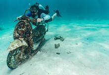 Diver Posing On Motorbike On The Ocean Floor At Phuket