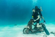 Divers Posing On Motorbike On The Ocean Floor At Phuket