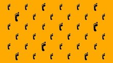 Feet Pattern On Orange Background