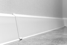 White Skirting Boards Close-up, Modern Apartment Interior Design Background Wit Selective Focus Composition