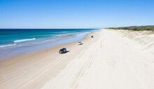 Holiday Makers Enjoying The Beach. Tourists Enjoy Driving And Stopping With Their Car, 4wd Driving On Infinite Beach.