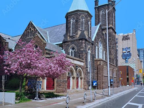 Fototapeta premium Toronto, Canada - Old stone church and reserved bike lane on Bloor Street near University of Toronto.