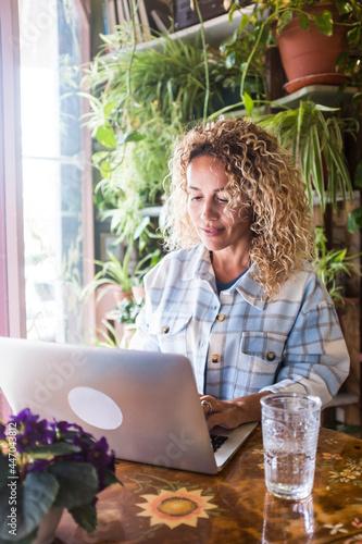 Fototapeta Adult woman work at computer laptop at home in digital smart working job activit