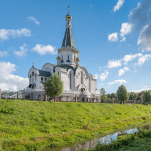 Temple Of The Holy Blessed Grand Duke Alexander Nevsky On The Bank Of The Lithuanian Stream Against The Backdrop Of The Dramatic Sky In Summer. Kaliningrad, Russia