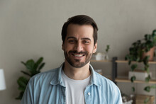 Head Shot Bearded Caucasian Cheery Man. Handsome Male Smile Look At Camera Standing Alone In Cozy Domestic Room. Successful Individual Entrepreneur Professional Occupation, Single Guy Portrait Concept
