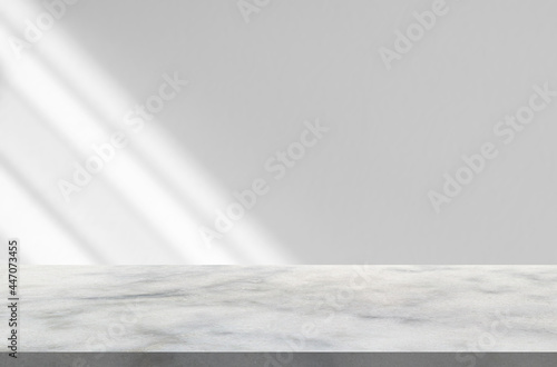Obraz na plátně Marble table with window shadow drop on white wall background for mockup product