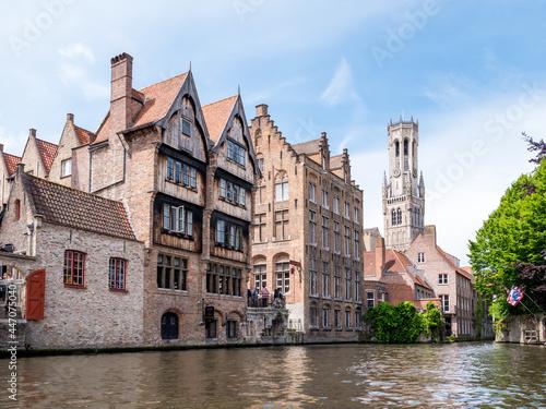 Billede på lærred Kraanrei canal with historic buildings and belfry tower in Bruges, Belgium