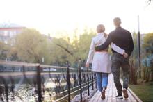 A Man And A Girl In Love On A First Date In An Autumn City Park.