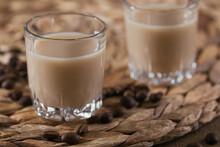 Short Glasses Of Irish Cream Liquor Or Coffee Liqueur With Coffee Beans