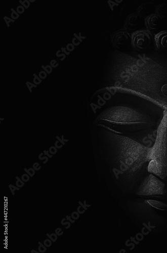 Murais de parede Black and white portrait vertical half face of the Buddha's monument