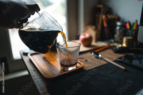Fototapeta drip coffee in house,Pouring a hot water over a drip coffee
