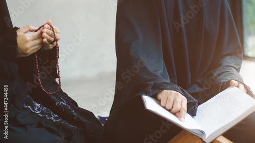 Fotografija Portrait of an Asian Muslim women in a daily prayer at home reciting Surah al-Fa