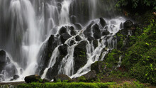Sao Miguel Island Waterfall Surrounded By Rocks Covered In Greenery In Azores, Portugal